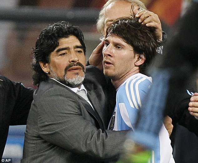 Messi is consoled by manager Diego Maradona after Argentina are eliminated in 2010