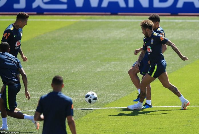 Neymar jostles for possession at Yug-Sport Stadium as Roberto Firmino receives the ball during a warm-up drill