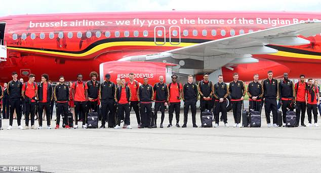 The whole team posed for a picture beside the plane at Brussels' national airport in Zaventem