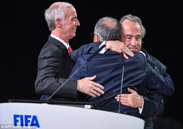 The join delegates from Canada, Mexico and the United States embrace in Moscow
