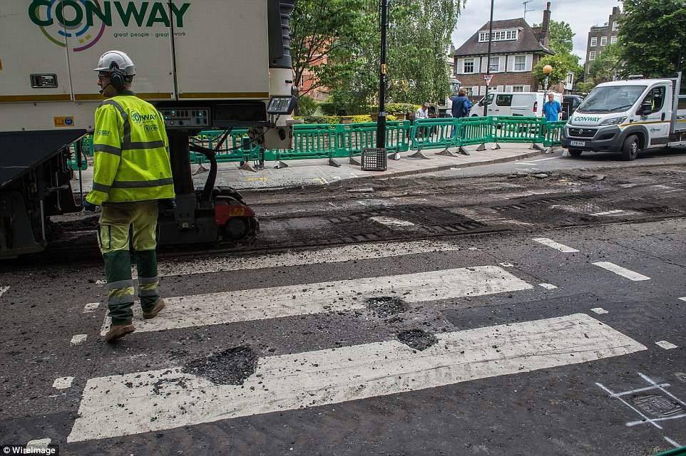It means tourists hoping to take pictures of the themselves walking over the crossing will have to contend with diggers and trucks spoiling the scene