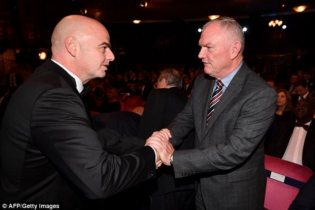 Ceferin has praised FA Chairman Greg Clarke (R) for having changed the image of FA globally