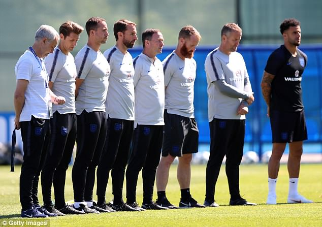 Manager Gareth Southgate and his coaching staff observe the silence for the Grenfell victims