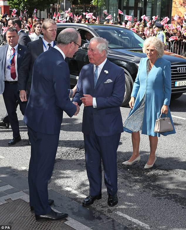 Charles, 69, and Camilla, 70, were met by flag-waving crowds as they arrived in Cork on the first day of the trip, which is being made at the Government's request