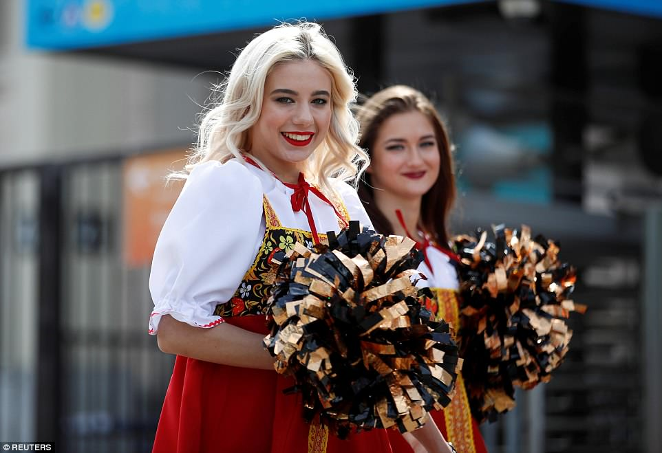 Cheerleaders in Russian traditional costume welcome supporters ahead of Thursday's World Cup opener in Moscow