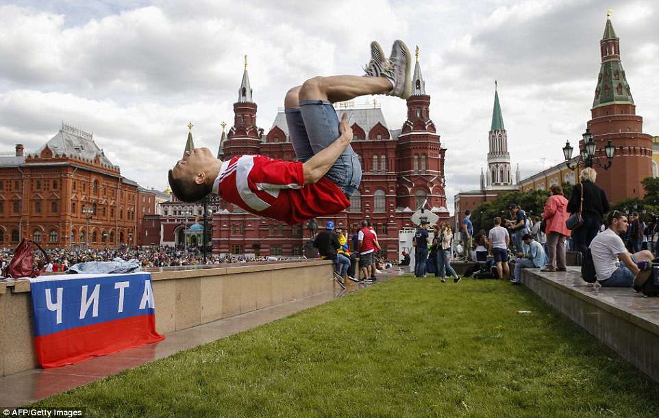 A fan performs a somersault in Manezhnaya Square in downtown Moscow as excitement builds ahead of the tournament