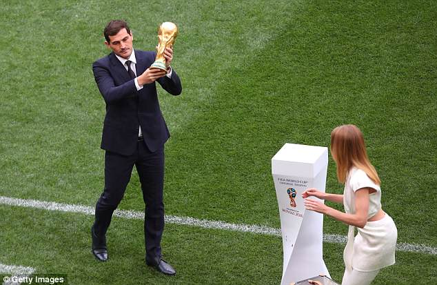 Casillas, who won the World Cup in 2010, shows off the coveted trophy in front of the fans