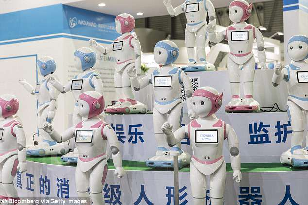 The humanoid device stands as tall as a five-year-old, moves and dances on wheels and its eyes keep track of its charges through facial recognition technology. Buyers at CES watched a performance of several iPals dancing in unison at the event (pictured)