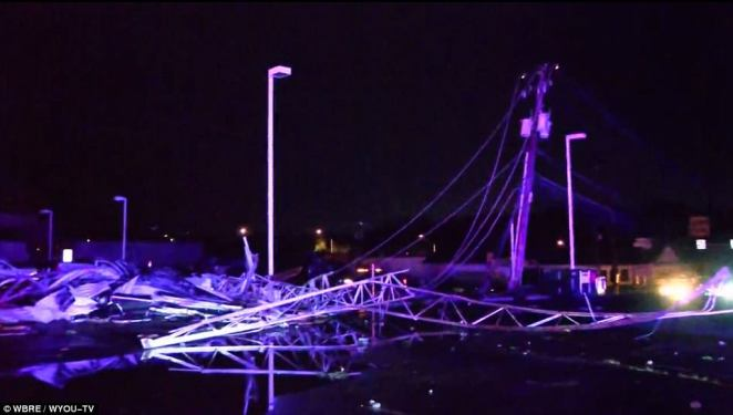 The violent storm downed trees and power lines, collapsed structures and hanging wires pictured above after the tornado