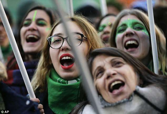 Women celebrate the approval of a bill in the streets of Buenos Aires, where the pope was who formerly the archbishop