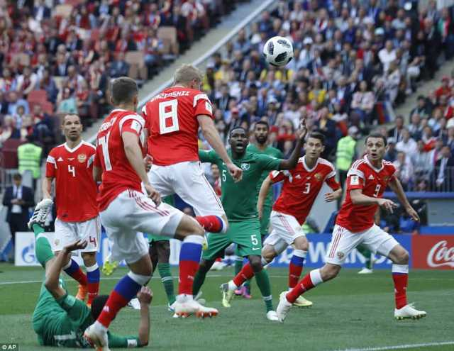 Russia  made a breakthrough when Gazinsky found himself unmarked at the back post to head homeGolovin's cross