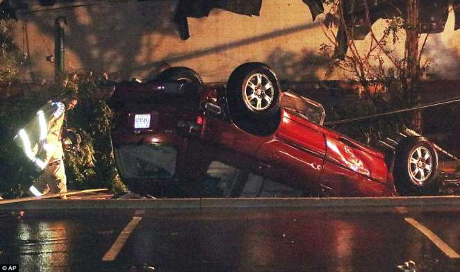 Emergency services arrived on the scene after the damage, an overturned car pictured above, only minor injuries reported