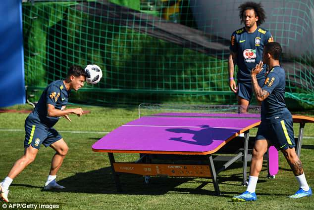 Philippe Coutinho heads the ball towards team-mate Marcelo during a game of head tennis