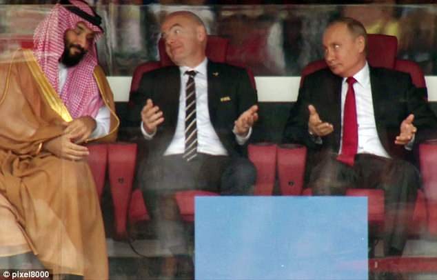 The Russian president and his FIFA counterpart Gianni Infantino shrug towards Saudi Arabia's Crown Prince Mohammad bin Salman after Russia scored a goal in the match