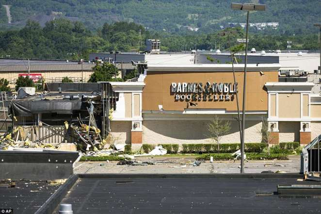 Wyoming Valley Mall strip mall suffered the greatest damage in the storm, with parts of the structure's exterior destroyed, pictured Thursday after the tornado hit