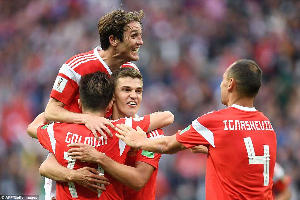 Russia's No 17 was promptly mobbed by his team-mates after completing their emphatic victory
