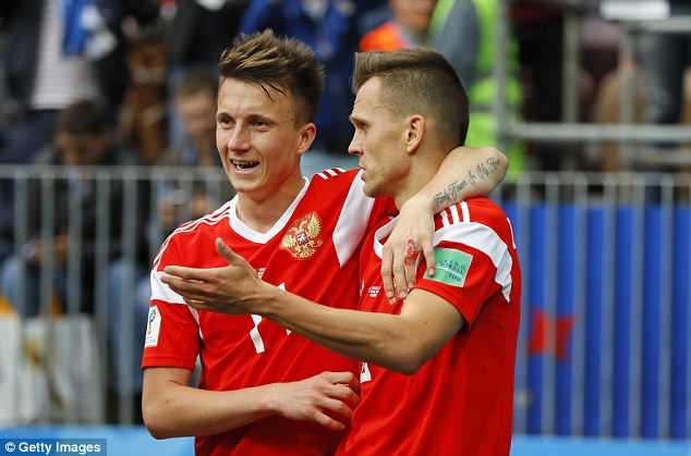 Aleksandr Golovkin celebrates with team-mate Denis Cheryshev after his first goal