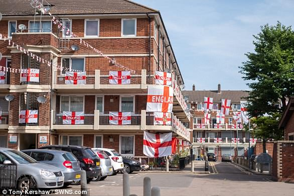 Patriotic: Residents at the Bermondsey estate first put up the decorations for the 2014 World Cup and their flag collection has grown year on year