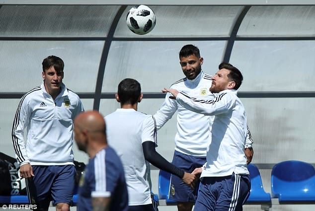 Messi keeps his eyes on the prize as he goes in for a header during the practice session
