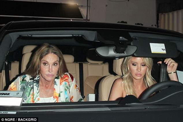 Ticket to ride: The 68-year-old reality television star sported a floral kimono and white trousers as she exited a vehicle being driven by her rumored girlfriend Sophia Hutchins, 21