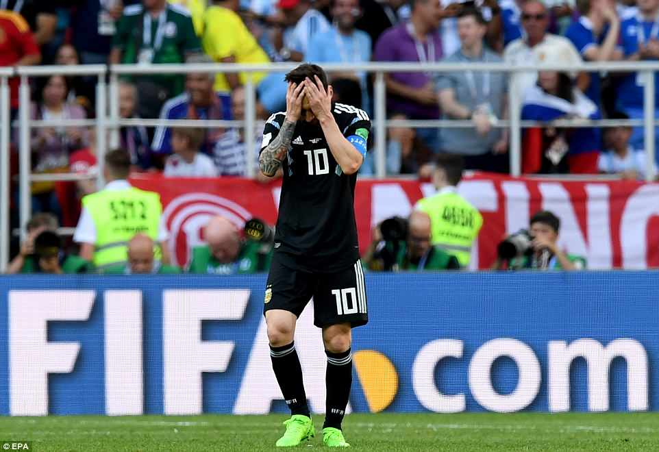 Lionel Messi has his head in his hands after seeing a second-half penalty saved by Iceland goalkeeper Hannes Halldorsson