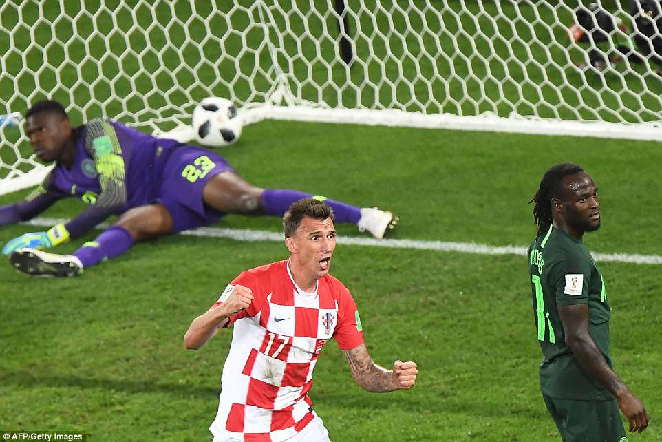 Striker Manduzkic celebrated by clenching both of his fists after Croatia made the breakthrough at theKaliningrad Stadium