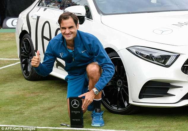 Roger Federer celebrates after securing the 98th tour-level title of his career in Stuttgart
