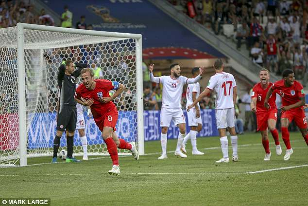 Harry Kane (No 9) scored a last-minute winner as England beat Tunisia 2-1 at the World Cup