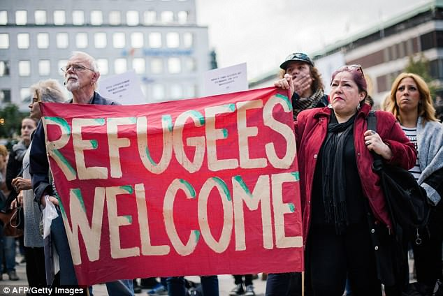 Hot debate: Sweden has registered 400,000 asylum applications since 2012, the number per capita of any EU nation. Pictured is a pro-migration demonstration in Stockholm in 2015