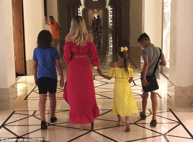 The whole gang:On how the family are coping in Rio's absence, loving Kate said: 'I'm with the kids on my own and obviously we miss him but we're having a nice time just us four as well'