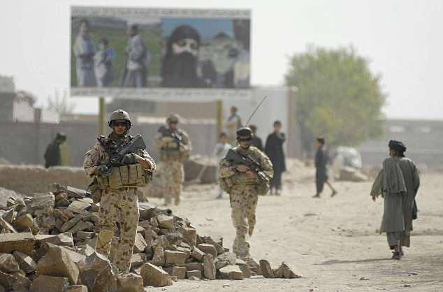 A Defence Force inquiry presided over by senior NSW judge Paul Brereton is investigating Australia's special forces regiment for war crimes, and is set to hand down its report next month. Pictured: Australian infantry in Afghanistan