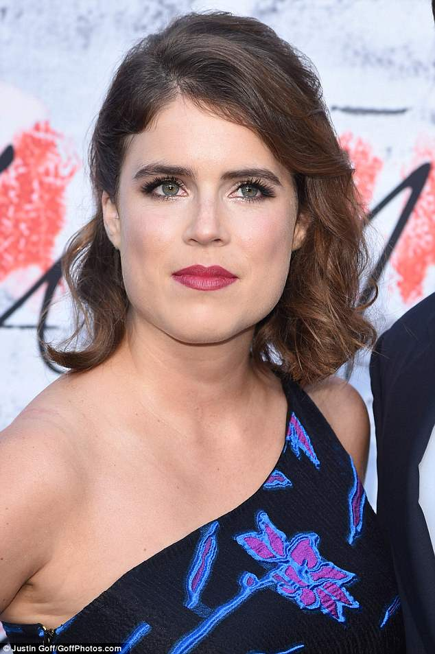 Princess Eugenie teamed the sheer number with black skinny jeans and vertiginous heels,adding a touch of glamour with a side parting and a slick of berry lipstick
