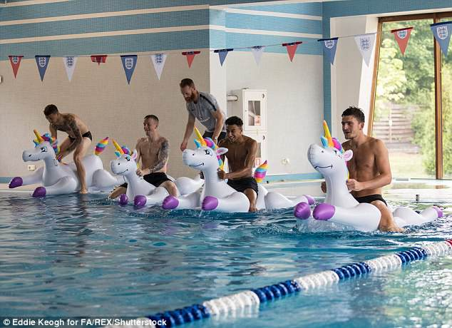 Kieran Trippier, Jordan Pickford, Jesse Lingard and Harry Maguire play with inflatable unicorns in the pool during a recovery session at the ForRestMix Hotel