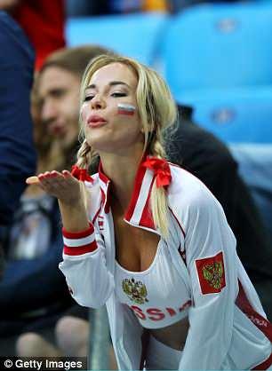 A Russian fan blows a kiss to the field