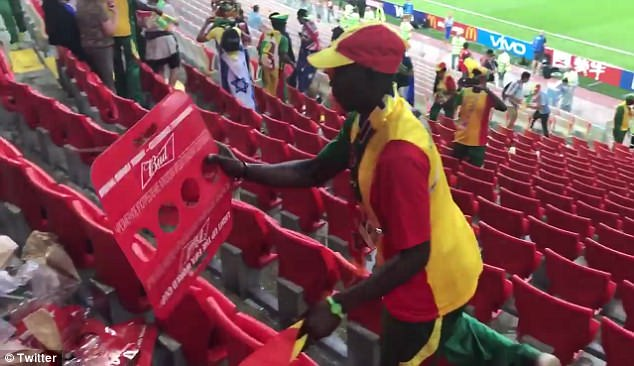 The Senegalese supporters could be seen cleaning up drink and food packaging on video