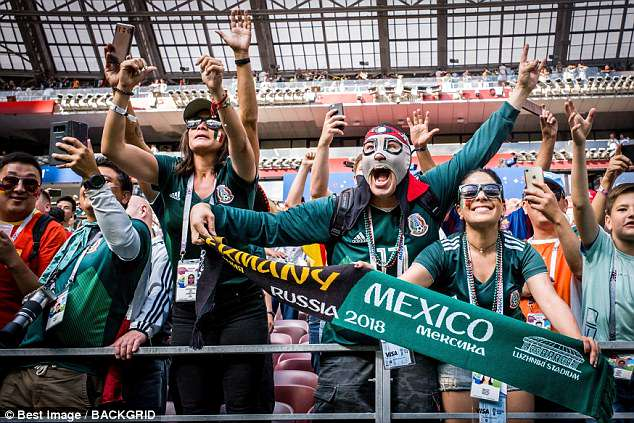Fans are seen celebrating after Mexico beat Germany 1-0 during Sunday's Wold Cup game