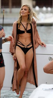 Stunner: AnnaLynne McCord flaunted her washboard abs on a yacht on Thursday
