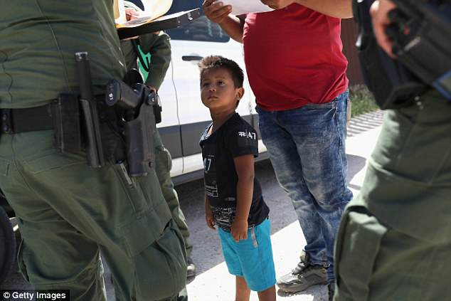 A boy and father from Honduras are taken into custody by U.S. Border Patrol agents near the U.S.-Mexico Border earlier this month in  Mission, Texas. Trump said today that Democrats don't actually care about the migrant families