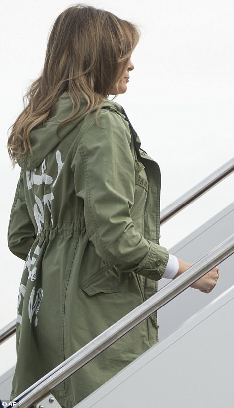 Shocking: The khaki green Zara design featured the controversial phrase across the back - with the wording visible from the side as Melania boarded her plane at Andrews Air Force Base