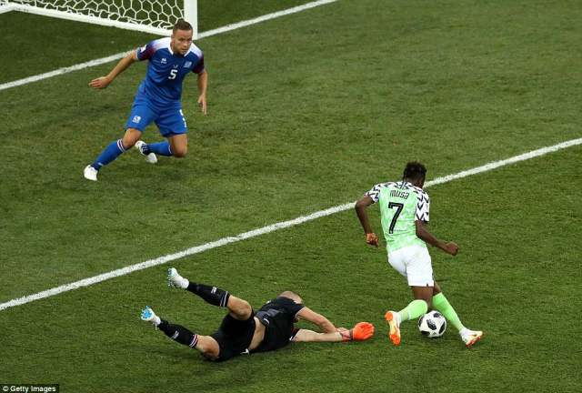 Musa of Nigeria scores his team's second goal in the 75th minute after going round Iceland goalkeeperHalldorsson