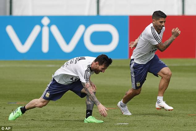 Messi (R) was in good spirits as he celebrated his 31st birthday by preparing for Nigeria game