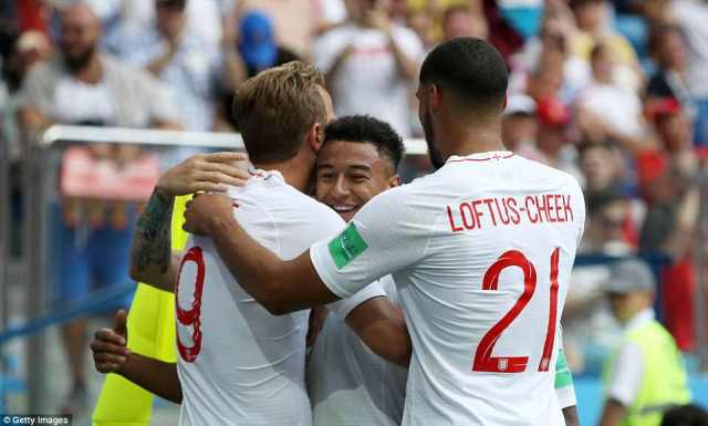 Jesse Lingard of England celebrates with teammates Harry Kane and Ruben Loftus-Cheek after scoring his team's third goal