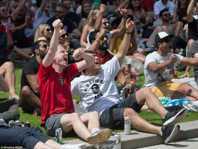 Football fans gather in Merchant Square in London's Paddington to watch England play Panama on a big screen