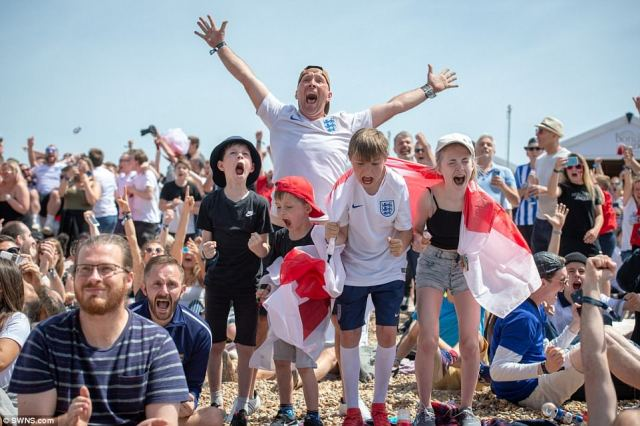 Fans celebrate at Brighton beach after England's demolition of Panama took them through to the knockout stages