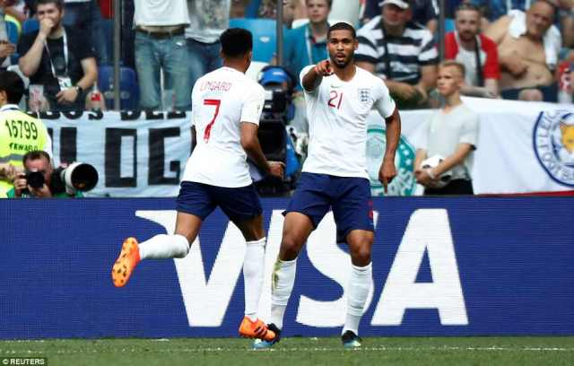 Jesse Lingard celebrates scoring a stunning third goal for England in Nizhny Novgorod with Ruben Loftus-Cheek