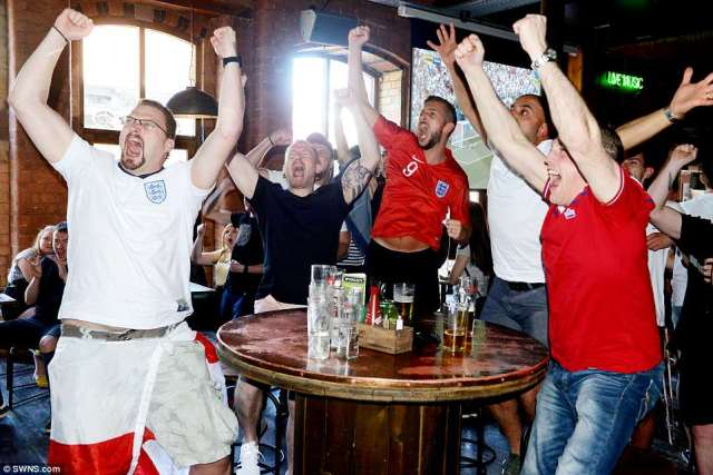 Fans celebrate whilst watching in McCooley's sports bar, Liverpool, as England race into a 5-0 lead before half time