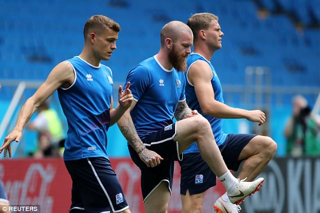 Aron Gunnarsson (centre) was among the Iceland players involved in training on Monday
