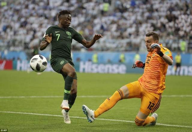 Ahmed Musa chases down a loose ball and Franco Armani is forced to scramble the ball clear to safety