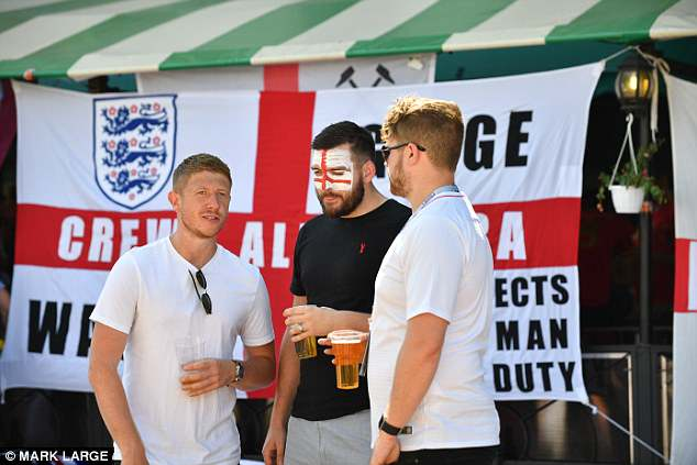 England fans enjoy a beer ahead of the World Cup match in Kaliningrad tonight