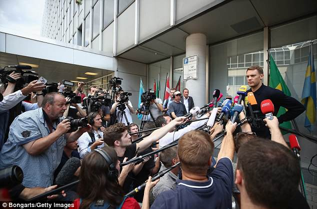 Captain and goalkeeper Manuel Neuer speaks to the press after their group stage elimination